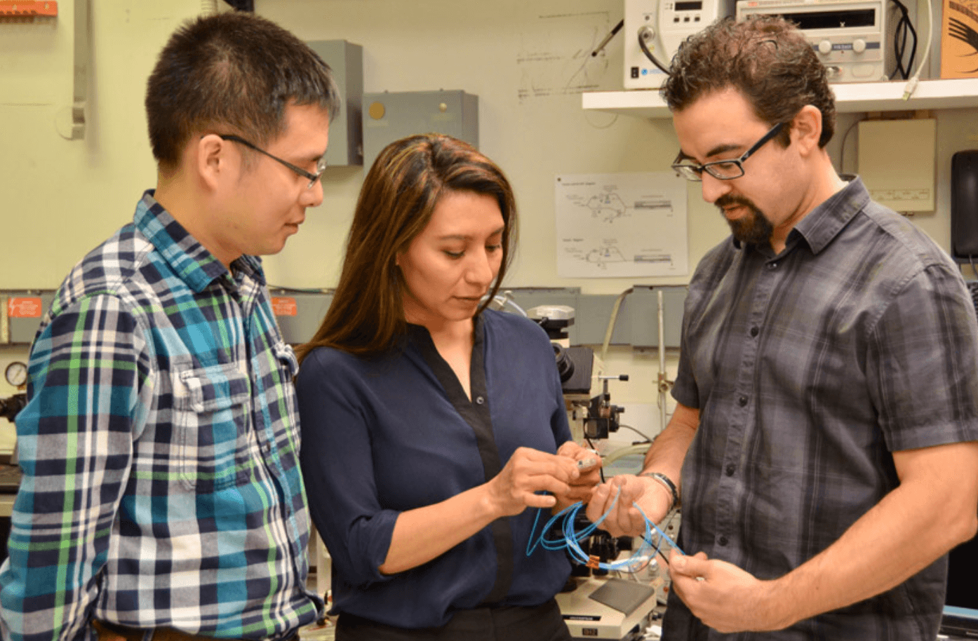 IBM Researchers Chi Xiong, Norma Sosa and Will Green prepare a sensor for testing in the lab.