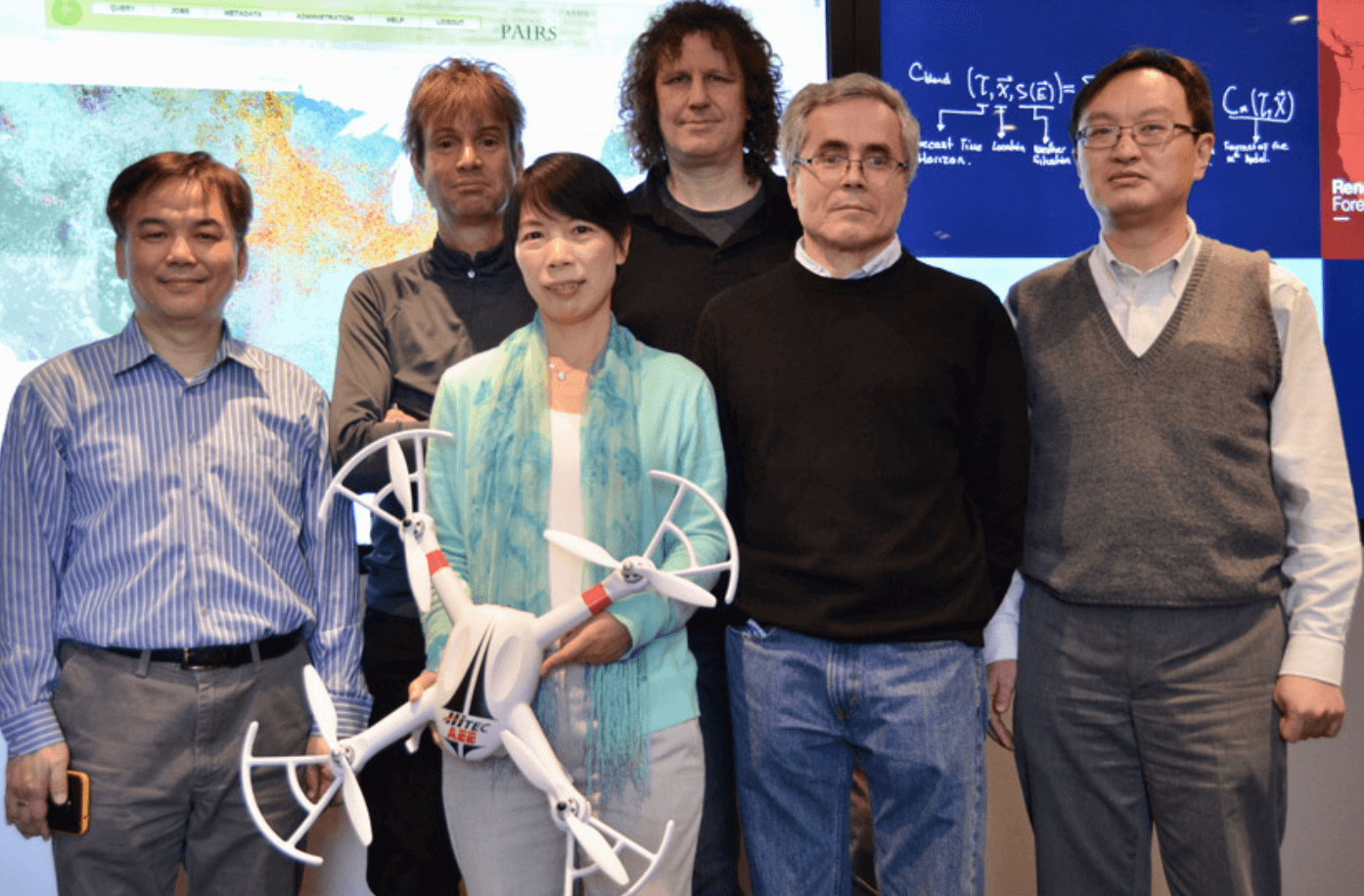The IBM Research team, six people 5 male o1 female: From left to right: Rong Chang, Hendrik Hamman, Xiaoyan Shao, Marcus Freitag, Ildar Khabibrakhmanov, Siyuan Lu.